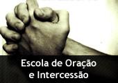 Mão juntas - com a inscrição Escola Oração e Intercessão