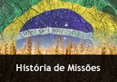Bandeira do Brasil sobre sólido árido e campo de trigo - com a inscrição História de Missões